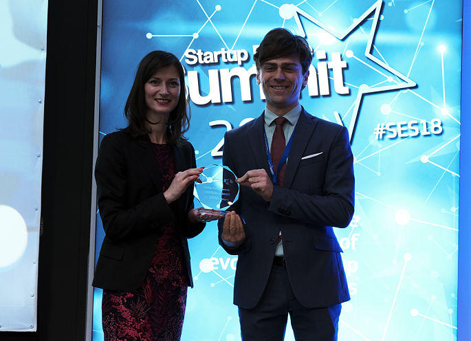 Picture of Commisioner Gabriel handing over prize to Simbound CEO Louis Havriliuc